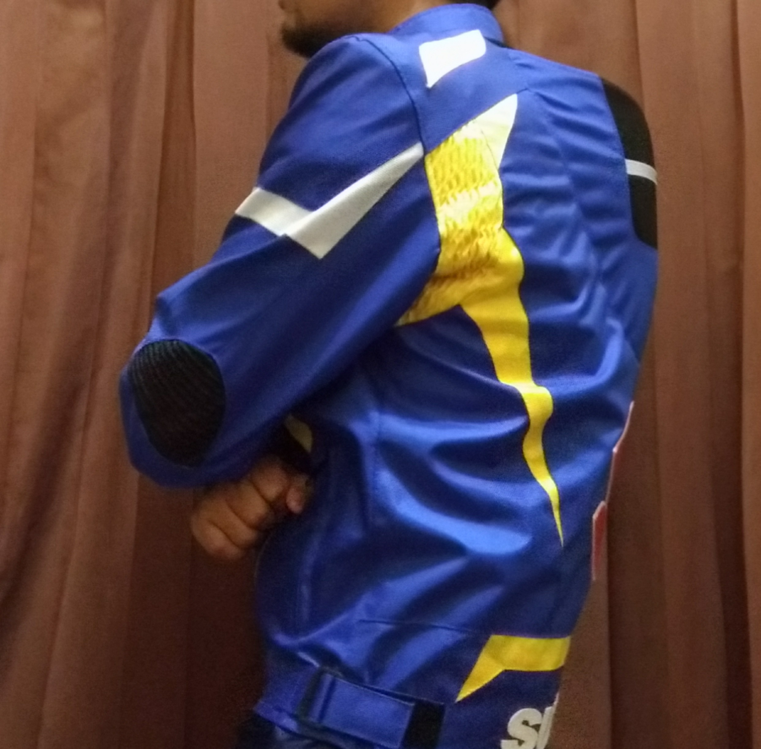 Review Jaket Suzuki Ecstar samping